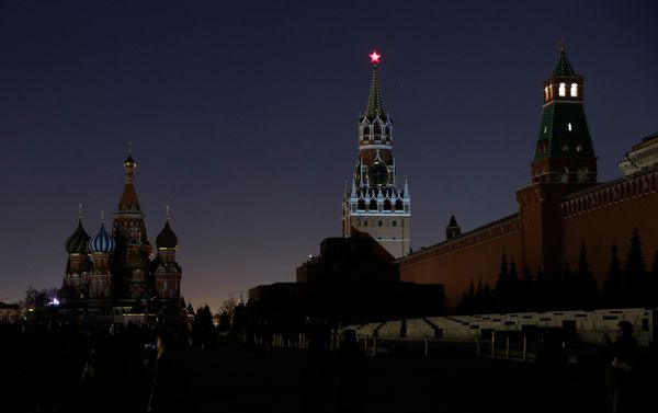A view shows the St. Basil's Cathedral (L) and the Kremlin wall, after the lights were switched off for Earth Hour in Red Squ