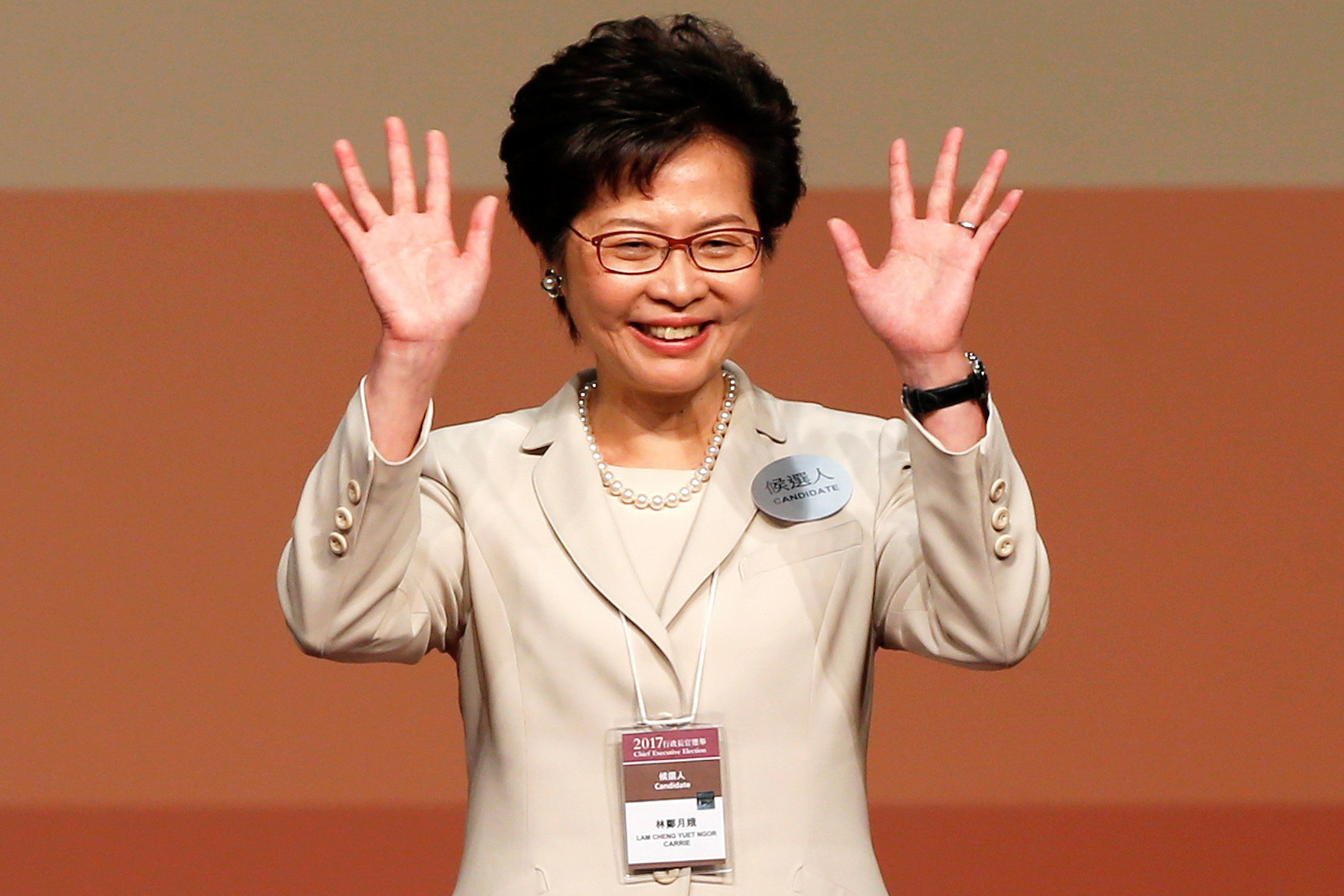 Carrie Lam waves after she won the election for Hong Kong's Chief Executive in Hong Kong, China March...