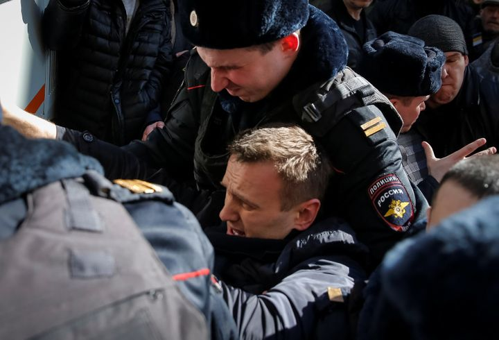 Police officers detain anti-corruption campaigner and opposition figure Alexei Navalny during a rally in Moscow, Russia, Marc