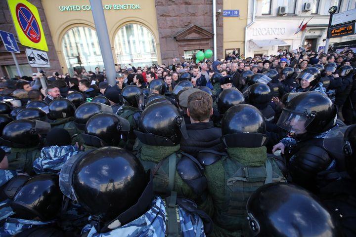 People take part in Russian opposition activist Alexei Navalny's anti-corruption rally in Tverskaya Street.
