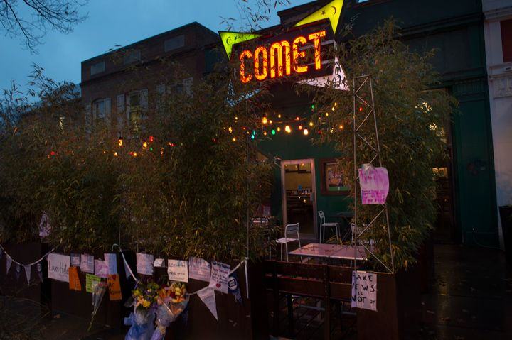 Signs of support hang outside of Comet Ping Pong in Washington, D.C., after an armed man stormed the restaurant in search of