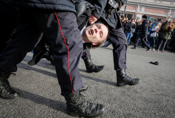 Law enforcement officers detain an opposition supporter in Moscow.