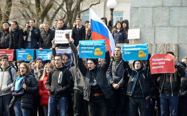 Opposition supporters raise signs in Vladivostok.
