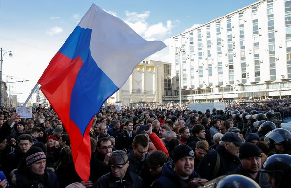 Protesters wave a Russian flag during a rally in Moscow.
