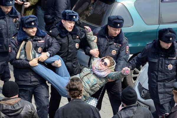 Police officers detain an opposition supporter during a rally in Vladivostok.