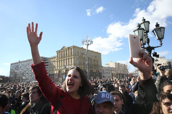 Opposition activists rally in front of the Pushkin monument in Moscow's Pushkinskaya Square.