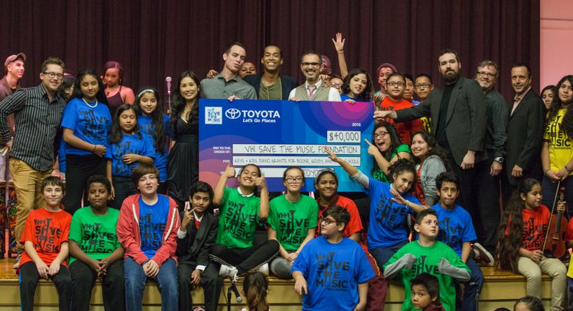 VH1's Save The Music Foundation visits a school to hand over a donation made possible by support from Toyota.