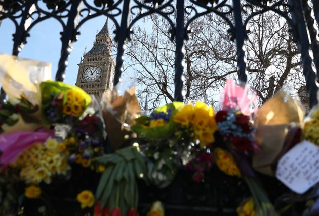 Floral tributes are tied to a fence in Parliament Square following the attack in Westminster earlier...