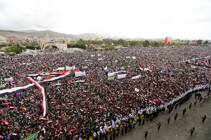 Supporters of the Houthi movement and Yemen's former president Ali Abdullah Saleh attend a joint rally to mark two years of t