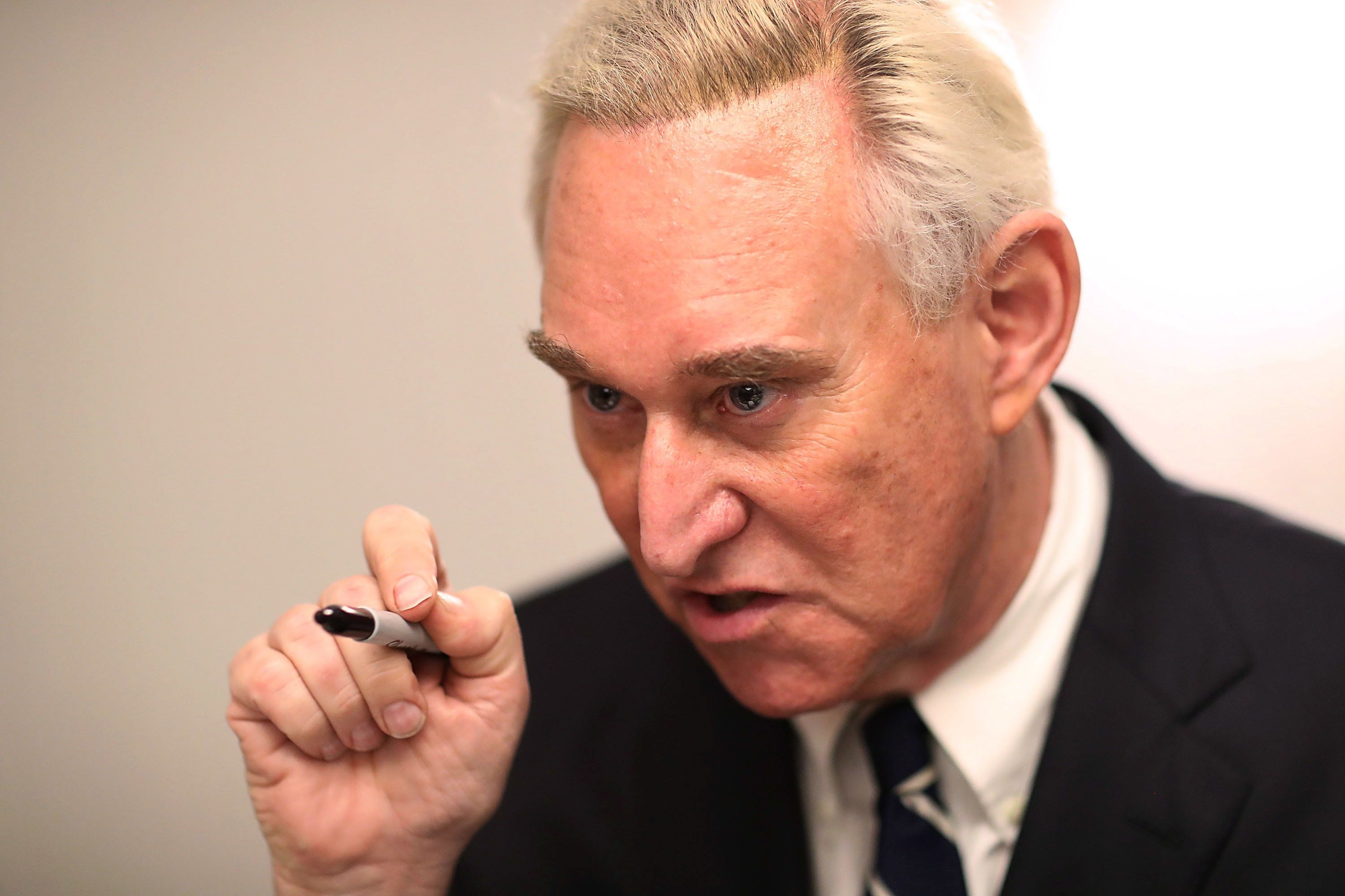 BOCA RATON, FL - MARCH 21:  Roger Stone, a longtime political adviser and friend to President Donald Trump, signs copies of his book 'The Making of the President 2016' at the Boca Raton Marriott on March 21, 2017 in Boca Raton, Florida.  The book delves into the 2016 presidential run by Donald Trump.  (Photo by Joe Raedle/Getty Images)