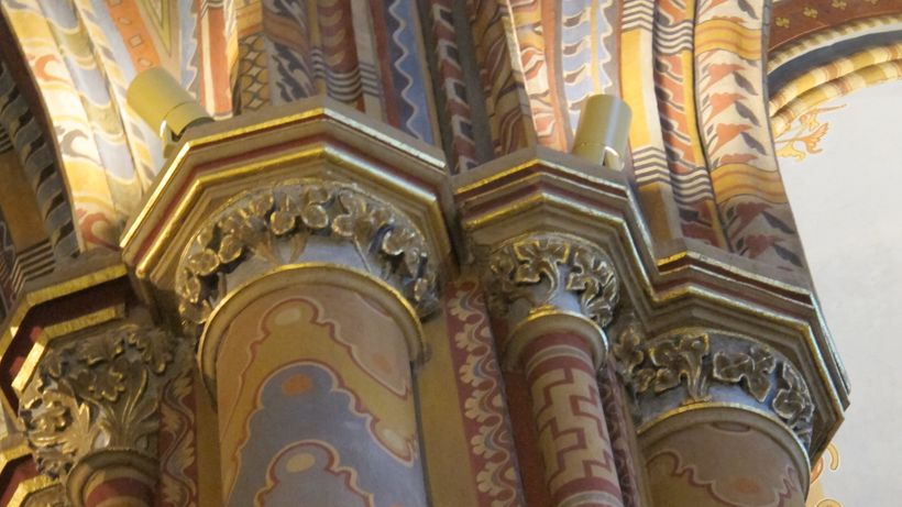 Magyar folk art themes on Gothic pillars inside Budapest's quirky Matthias Church.