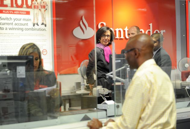 Former Santander CEOAna Patricia Botin speaks to members of staff in a branch in this file