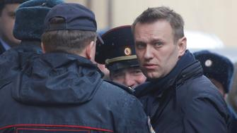 Russian opposition leader Alexei Navalny is escorted upon his arrival for a hearing after being detained at the protest against corruption and demanding the resignation of Prime Minister Dmitry Medvedev, at the Tverskoi court in Moscow, Russia March 27, 2017. REUTERS/Maxim Shemetov     TPX IMAGES OF THE DAY