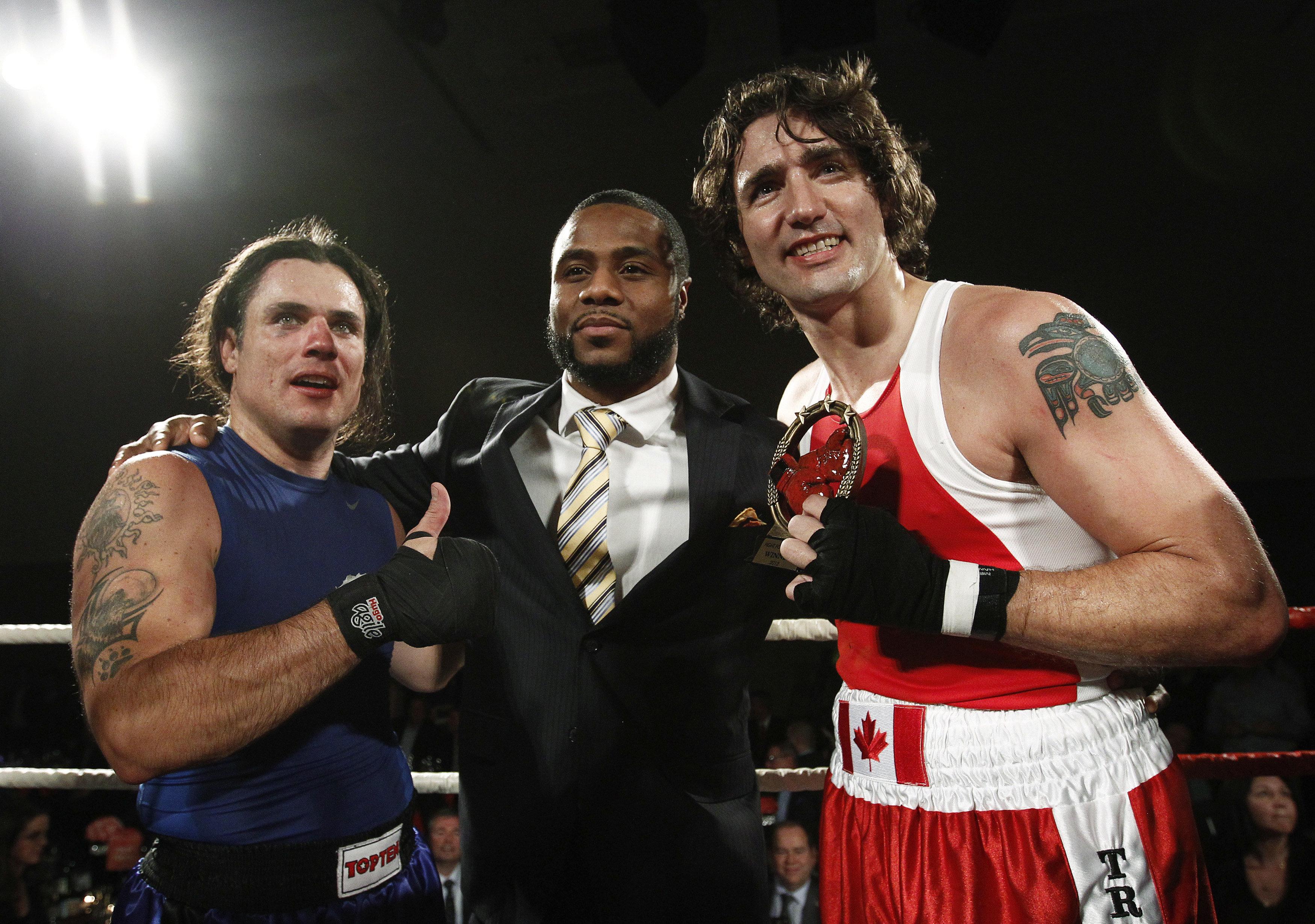 Trudeau (R) and conservative Senator Patrick Brazeau (L) pose after Trudeau defeated Brazeau during their...