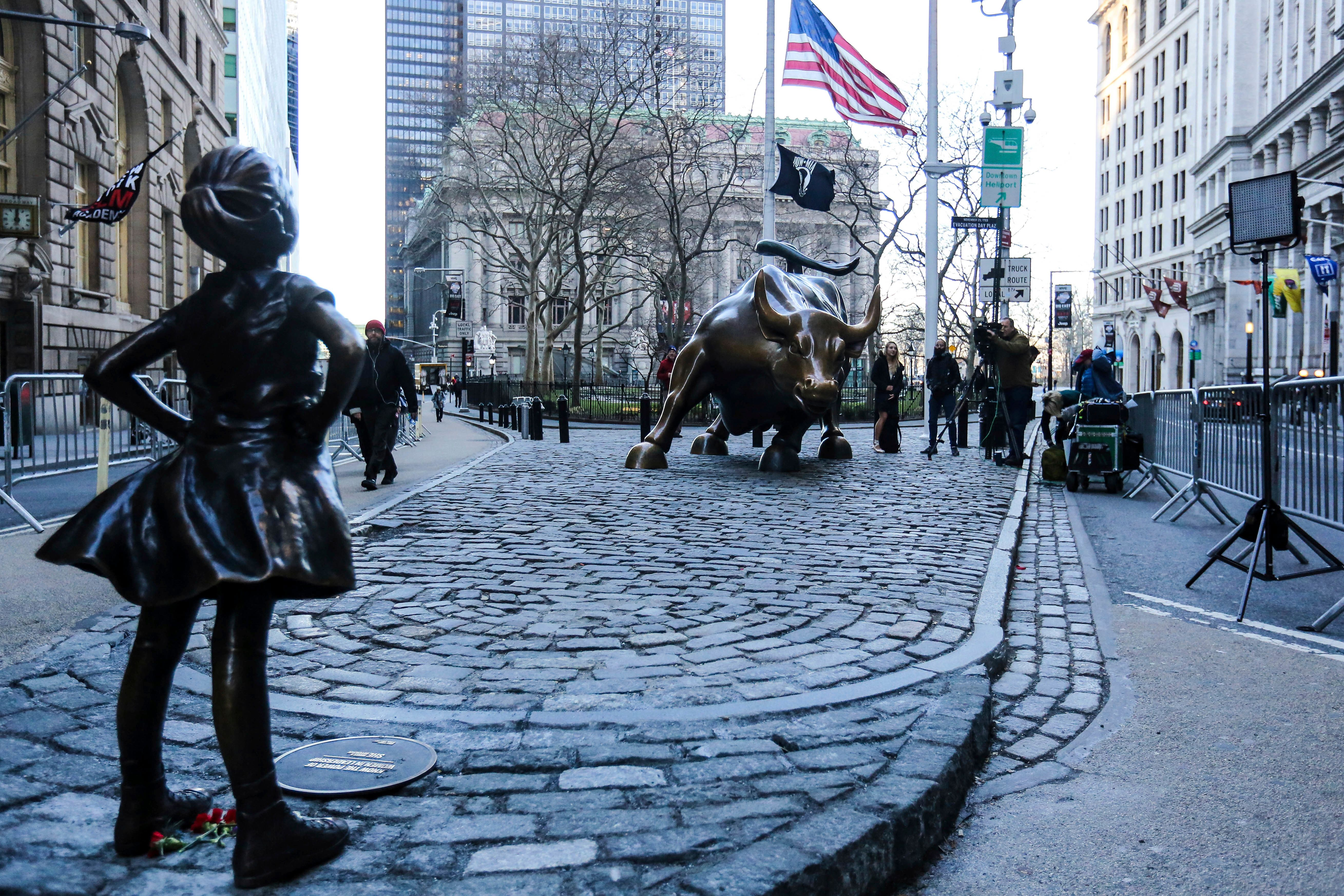 Hundreds of tourists take photos of 'The Fearless Girl' statue as it stands across from the Wall Street's famous Charging Bul