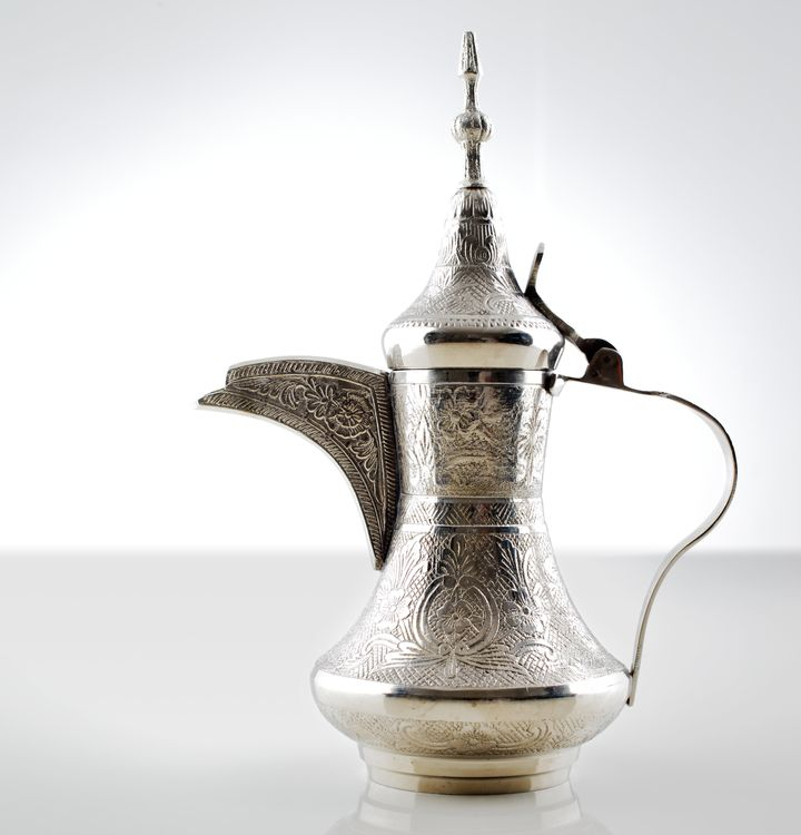 A very ornate dallah, used for making arabic coffee.