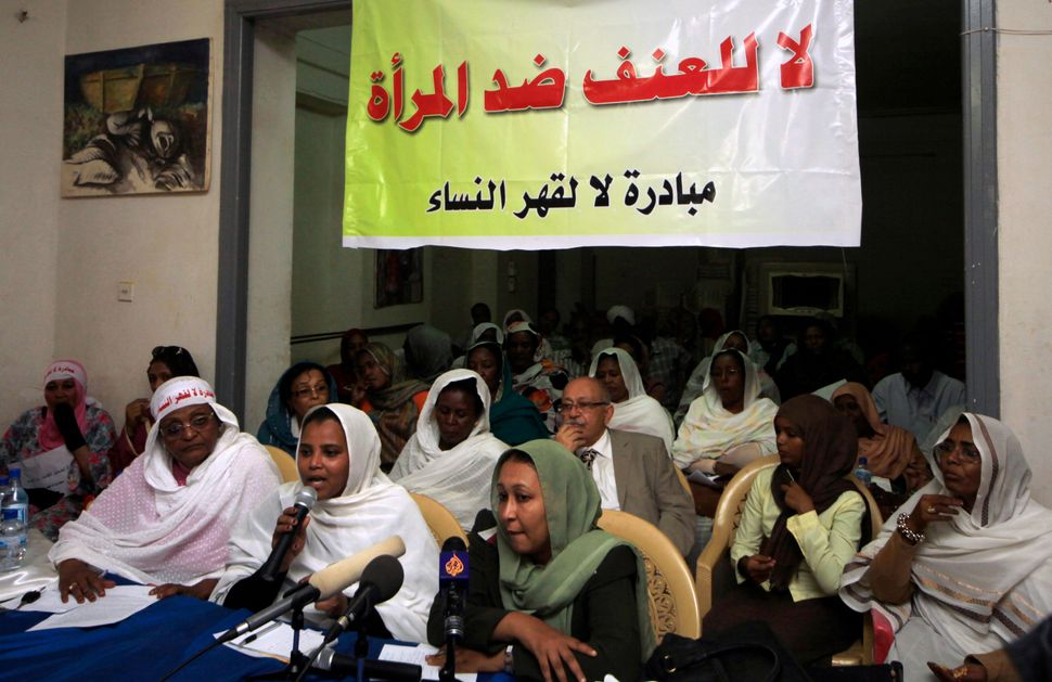Sudanese women who were earlier arrested for protesting against laws they say humiliate women speak at a news conference at t