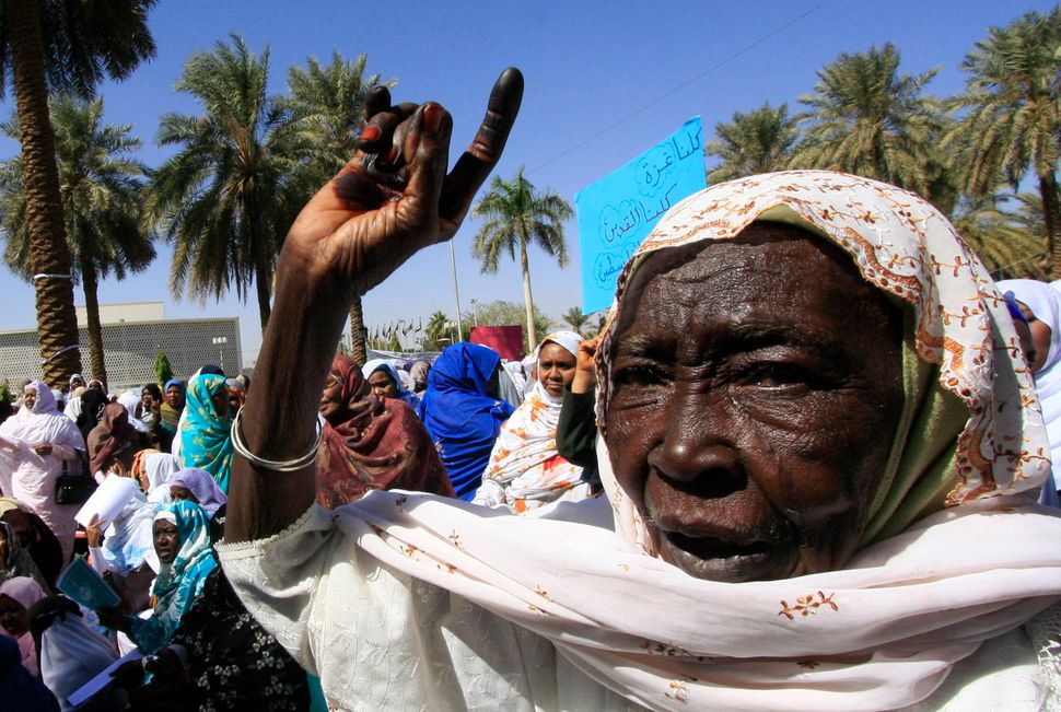 A Sudanese woman shouts slogans during a demonstration against the Israeli offensive in Gaza Strip in Khartoum Jan. 5, 2009.