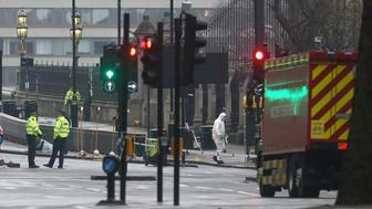REFILE CORRECTING BYLINE Forensics investigators and police officers work at the site near Westminster Bridge the morning after an attack by a man driving a car and weilding a knife left five people dead and dozens injured, in London, Britain, March 23, 2017.  REUTERS/Neil Hall