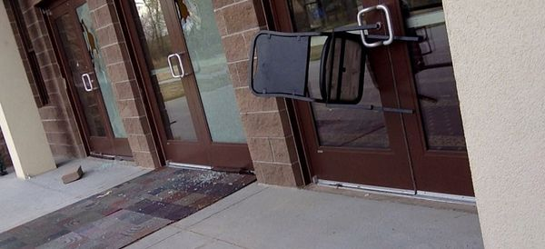 Someone Threw A Bible And Rocks Through The Glass Doors Of A Mosque