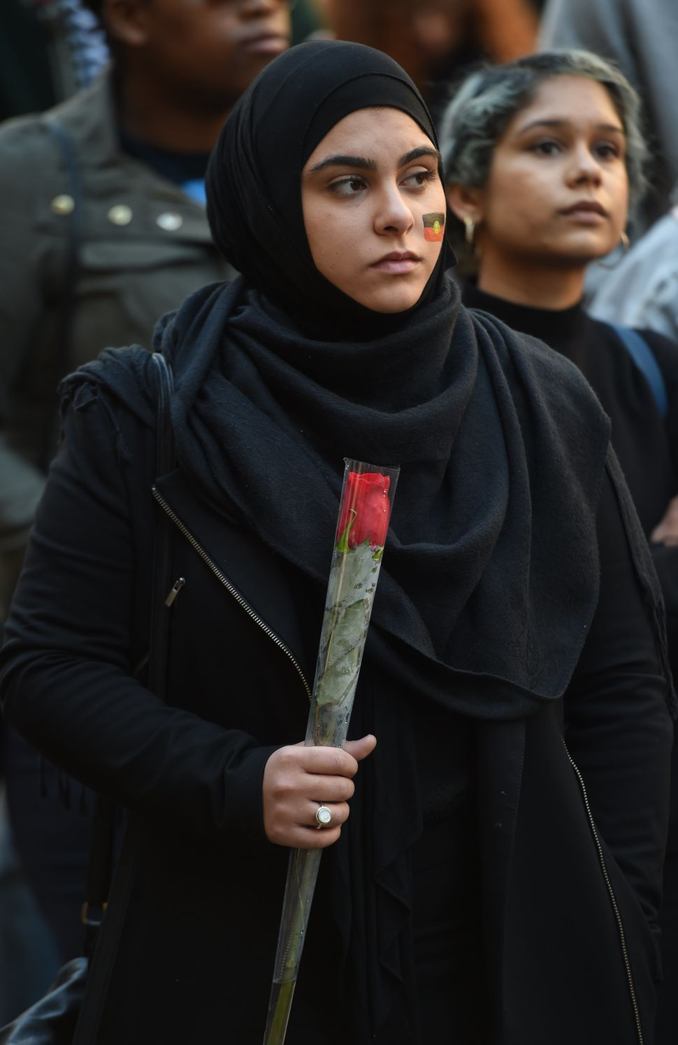 A Muslim woman holds a rose at a Black Lives Matter rally in Sydney on July 16, 2016. Some 300 people gathered at the rally i