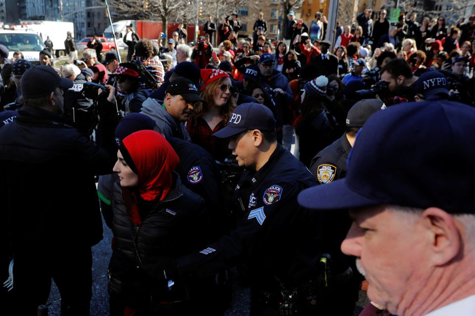 New York Police Department officers arrest organizer Linda Sarsour who was taking part in a 'Day Without a Woman' march on In