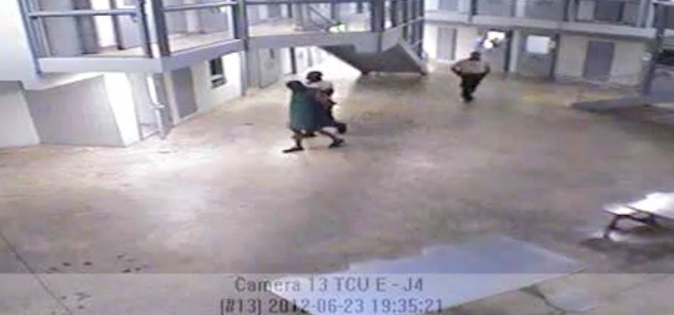 In surveillance video the night inmate Darren Rainey died, Rainey is seen being escorted from his cell to the shower by a gua