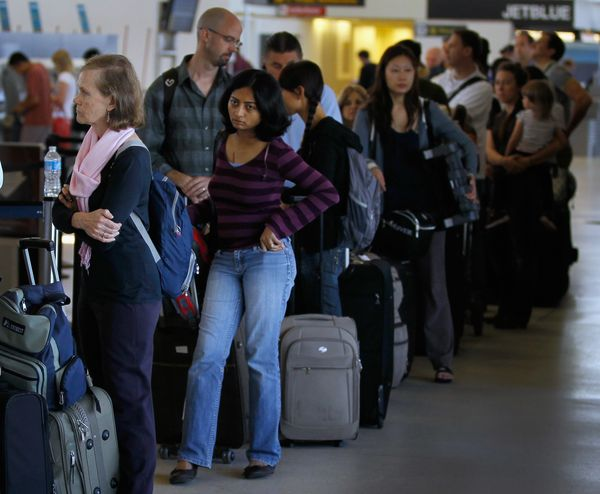 Airline travellers stand in line to get to the United airlines ticketing counter at Newark Airport in Newark, New Jersey on A