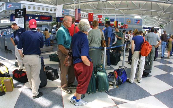Travelers stand in line at the United Airlines terminal at O''Hare International Airport in Chicago, Illinois on June 18, 200