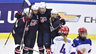 Players from the U.S. team (L-R) Kandall Coyne, Brianna Decker , Hilary Knight, and Emily Pfalzer celebrate Deckers 1-1 goal during the 2015 IIHF Ice Hockey Women's World Championship semi-final match against Russia at Malmo Isstadion in Malmo, April 3, 2015. REUTERS/Claudio Bresciani/TT News Agency   ATTENTION EDITORS - THIS IMAGE HAS BEEN SUPPLIED BY A THIRD PARTY. IT IS DISTRIBUTED, EXACTLY AS RECEIVED BY REUTERS, AS A SERVICE TO CLIENTS. SWEDEN OUT. NO COMMERCIAL OR EDITORIAL SALES IN SWEDEN. NO COMMERCIAL SALES.