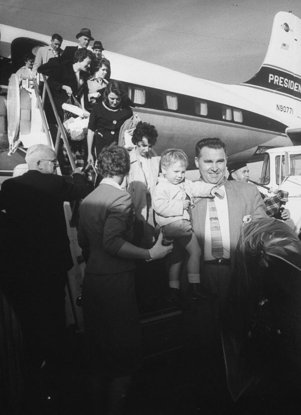 Passengers getting off of a tardy chartered plane on Oct. 1, 1961.