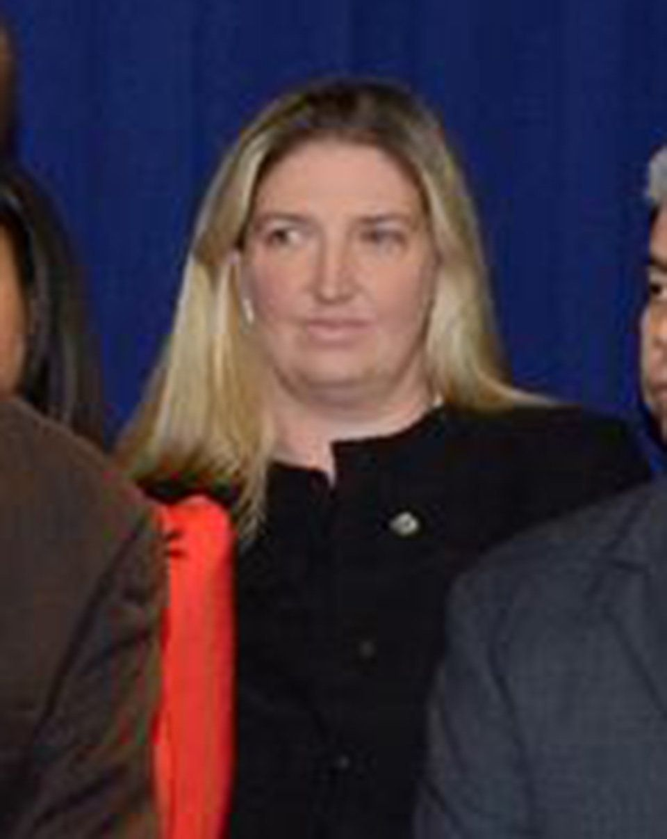 Tara Lenich is seen in the background of a Brooklyn District Attorney photo on Facebook