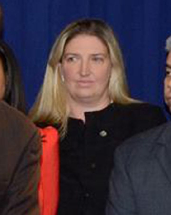 Tara Lenich is seen in the background of a Brooklyn District Attorney photo on Facebook.