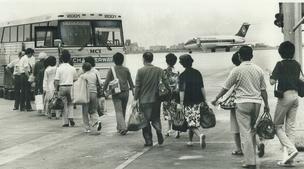 Passengers taking a bus to get to a connecting flights in Niagara Falls, N.Y.
