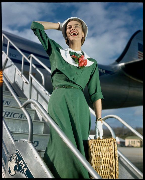 A model poses walking off the Pan American Clipper