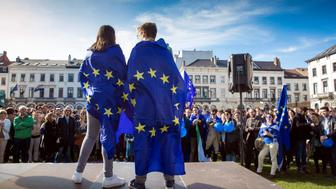 People hold Europen flags as they take part in the 'March For Europe' on the occasion of the 60th anniversary of the European Union on March 25, 2017 in Brussels. Leaders of 27 European Union countries on March 25, 2017 marked the 60th anniversary of the bloc's founding by renewing their commitment to a common future. Against a backdrop of crises and in the absence of the departing Britain, the leaders signed a new Rome declaration, six decades after the six founding members signed the Treaty of Rome and gave birth to the European Economic Community.  / AFP PHOTO / BELGA / Koen BLANCKAERT / Belgium OUT        (Photo credit should read KOEN BLANCKAERT/AFP/Getty Images)