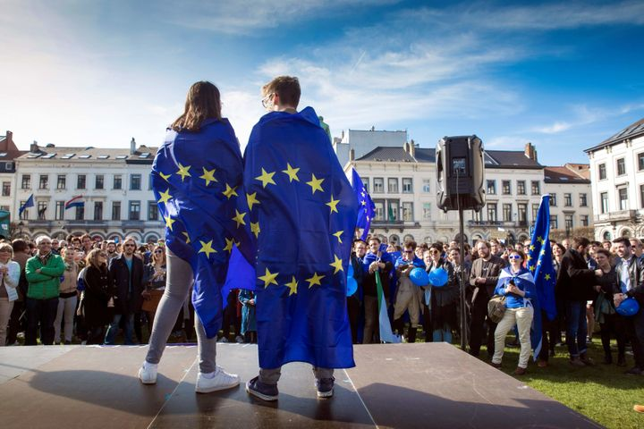 People hold European flags as they take part in the March For Europe on the 60th anniversary of the EU. March 25, Brusse