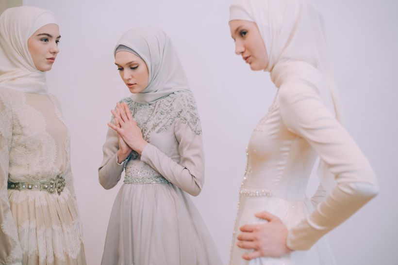 Models backstage during Firdaws runway show led by Aishat Kadyrova at Mercedes-Benz Fashion Week Russia