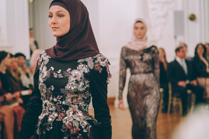 Models present gowns during Firdaws runway show led by Aishat Kadyrova at Mercedes-Benz Fashion Week Russia