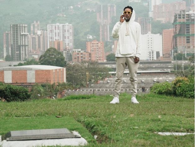 Wiz Khalifa chills at grave of Pablo Escobar in Medillin Colombia