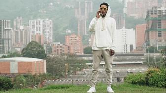 Wiz Khalifa chills at grave of Pablo Escobar in Medillin Colombia