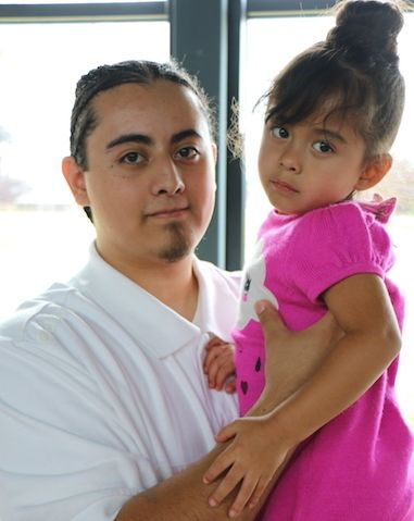 Daniel visiting with his daughter Mila at Green Hill School Juvenile Detention Center before he was transferred to the adult
