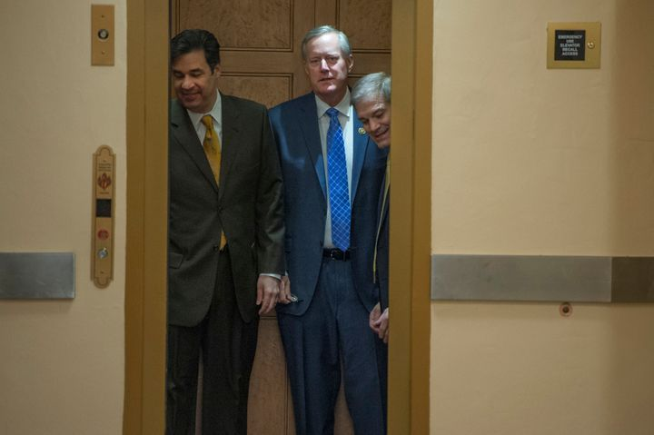 House Freedom Caucus members Raul Labrador (R-Idaho), left, Mark Meadows (R-N.C.) and Jim Jordan (R-Ohio) head to the House f