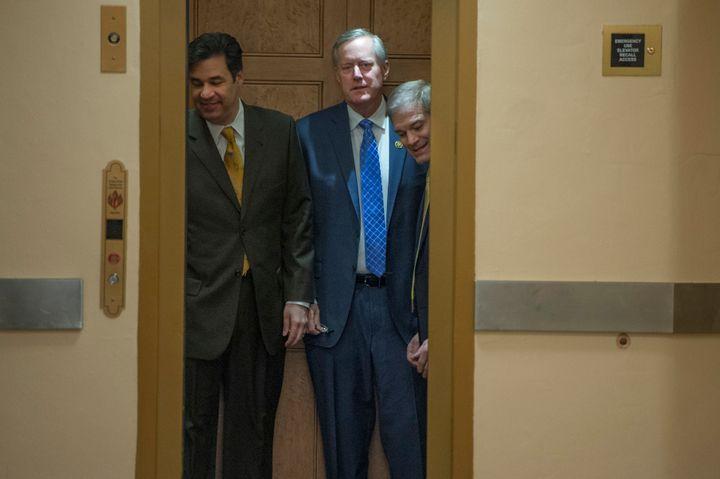 House Freedom Caucus members Raul Labrador (R-Idaho), left, Mark Meadows (R-N.C.) and Jim Jordan (R-Ohio) head to the House f