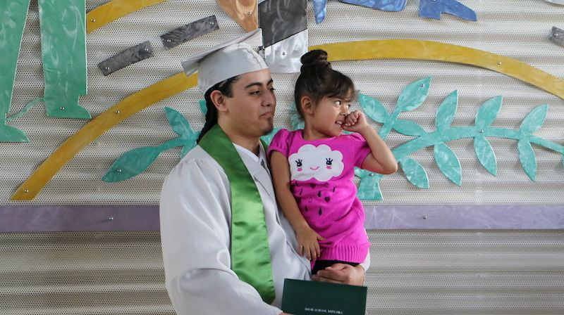 <em>Daniel with his daughter Mila at his graduation at Green Hill School Juvenile Detention Center.</em>