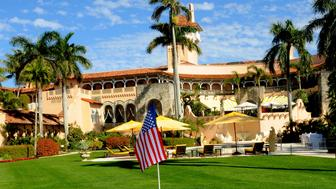 View of an American flag on a flagstick in a golf course hole on the west lawn of the Mar-a-Lago estate, Palm Beach, Florida, February 13, 2017. (Photo by Davidoff Studios/Getty Images)