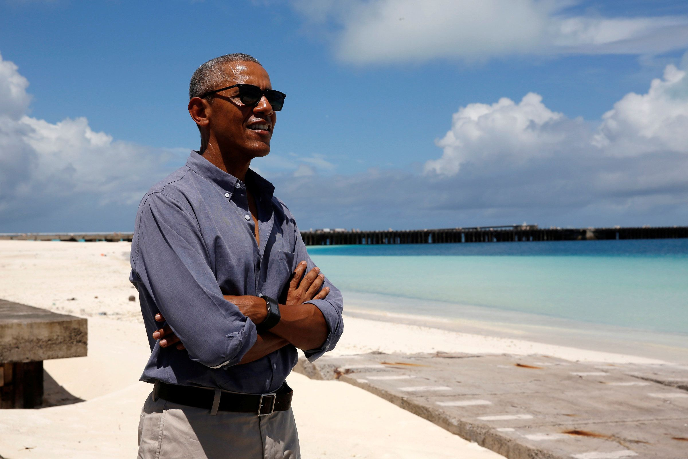 Yes, this is a real photo, but it's not on Tetiaroa. Barack Obama smiles as he looks out at Turtle Beach on a visit to P