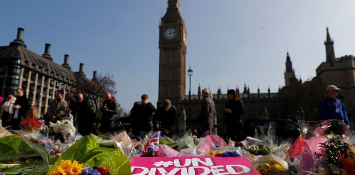 Floral tributes lie in Parliament Square following the March 27 2017 attack in Westminster, central London, Britain.