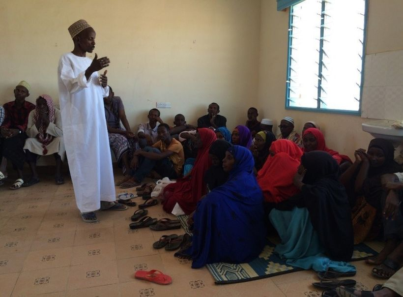 <em>A religious leader in Kenya explains to a group of men and women in Kenya that family planning is important to their heal