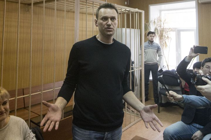 Russian opposition politician Alexei Navalny appears in a courtroom after being detained during an anti-corruption